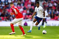 Marcus Rashford of England is challenged by Nikolay Bodurov of Bulgaria - Rogan/JMP - 07/09/2019 - FOOTBALL - Wembley Stadium - London, England - England v Bulgaria - UEFA Euro 2020 Qualifiers.