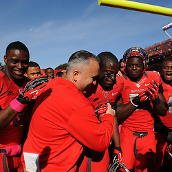 Oct 13, 2012: Rutgers Scarlet Knights head coach Kyle Flood celebrates victory with his players in NCAA Big East college football action between the Rutgers Scarlet Knights and Syracuse Orange at High Point Solutions Stadium in Piscataway, N.J.