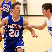 Wilmington Christian's Jacob Tew drives around Bethel's Caleb Dula during the consolation game of the Trask Holiday Tournament. (Jason A. Frizzelle)