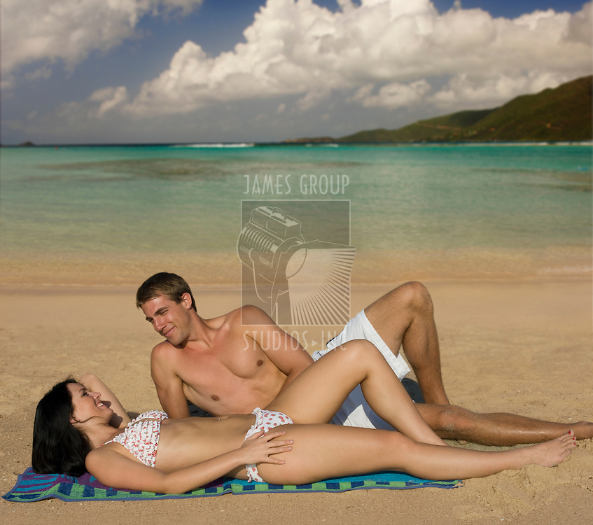 Attractive, young couple enjoying the solitude of a tropical beach