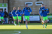 Forest Green players come out for the warm up during the EFL Sky Bet League 2 match between Forest Green Rovers and Cheltenham Town at the New Lawn, Forest Green, United Kingdom on 25 November 2017. Photo by Shane Healey.