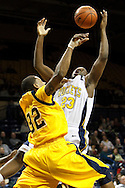 26 January 2010:  Kent State's Rodriquez Sherman (32) and Toledo's Malcolm Griffin (23) during the NCAA basketball game between Kent State and the Toledo Rockets at Savage Arena in Toledo, OH.