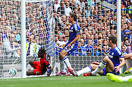 Nathan Dyer of Swansea City follows the ball into the net after his team take the lead via an own goal against Chelsea during the Barclays Premier League match at Stamford Bridge, London<br /> Picture by David Horn/Focus Images Ltd +44 7545 970036<br /> 13/09/2014
