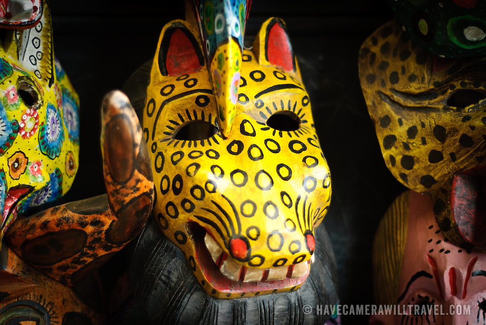 A carved wooden mask of a horse's for sale in a market in Antigua Guatemala. Famous for its well-preserved Spanish baroque architecture as well as a number of ruins from earthquakes, Antigua Guatemala is a UNESCO World Heritage Site and former capital of Guatemala.