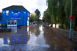© Licensed to London News Pictures. 26/10/2019. Builth Wells, Powys, Wales, UK. The A483 road is closed. Following very heavy rainfall for several days, extremely high river levels of the River Wye and River Irfon, flood parts of the Welsh market town of Builth Wells in Powys, UK. causing damage to property. Photo credit: Graham M. Lawrence/LNP