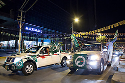 © Licensed to London News Pictures. 27/04/2014. Sulaimaniya, Iraq. With vehicles decked out with flags bearing the symbol of the Patriotic Union of Kurdistan (PUK) political party make their way down the main street of Sulaimaniya, Iraqi-Kurdistan during celebrations in the lead up to the 2014 Iraqi parliamentary elections.<br /> <br /> Although banned in other parts of Iraqi-Kurdistan, the days leading up to an election in Sulaimaniya sees political supporters of all the three main parties parading up and down the main street of the city, waving flags, honking horns, letting off fireworks and firing pistols and rifles into the air.<br /> <br /> The period leading up to the elections, the fourth held since the 2003 coalition forces invasion, has already seen six polling stations in central Iraq hit by suicide bombers causing at least 27 deaths. Photo credit: Matt Cetti-Roberts/LNP