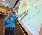 John McAlpine points out his thoughts for Jordan High School during a Jordan and Madison High School design charrette at the Houston Food Bank, May 29, 2015.