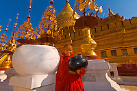 Novice monk holding alms bowl at the Shwezigon Pagoda, Bagan, Myanmar (Burma)