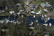 Aerial view of boats blown out of the water by Hurricane Katrina when it pummelled the Mississippi Gulf Coast, pictured is Pass Christian Mississippi the morning after Hurricane Katrina Aug. 30, 2005.©SUZI ALTMAN PHOTOGRAPHER
