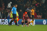 Football - 2019 / 2020 Premier League - AFC Bournemouth vs. Wolverhampton Wanderers<br /> <br /> Bournemouth's Steve Cook on his haunches after the final whistle at the Vitality Stadium (Dean Court) Bournemouth <br /> <br /> COLORSPORT/SHAUN BOGGUST