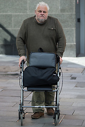 """© Licensed to London News Pictures . 10/04/2015 . Manchester , UK . """" CAPTAIN """" RICHARD WILLIAMS outside Manchester Crown Court today (10th April 2015) . Williams faces jail for instigating a £1.1million VAT fraud , spending the money on luxury cars , holidays and having a replica German U-boat built as a home-cum-museum . Photo credit : Joel Goodman/LNP"""