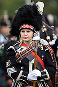Drum Major of a massed band of Scottish pipers at the Braemar Games Highland Gathering, Scotland, UK