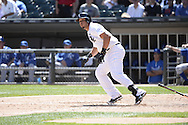 CHICAGO - JUNE 14:  Jose Abreu of the Chicago White Sox bats against the Kansas City Royals on June 14, 2014 at U.S. Cellular Field in Chicago, Illinois.   (Photo by Ron Vesely)