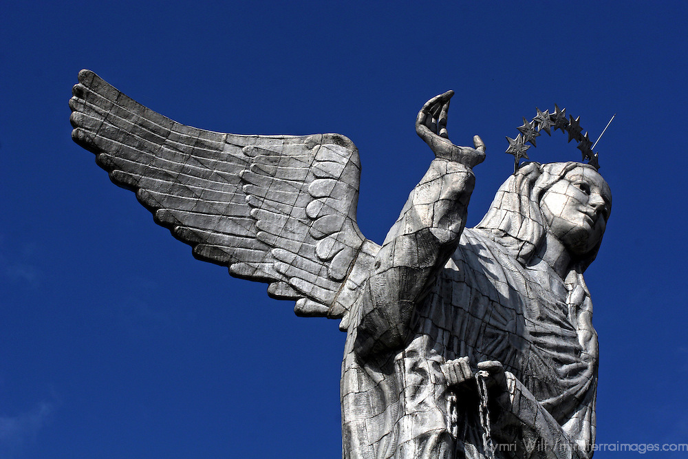 South America, Ecuador, Quito. The Virgin of Panecillo watches over the capitol of Ecuador against a blue sky.
