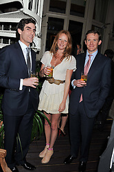 Left to right, LORD DANIEL COMPTON, OLIVIA INGE and ? at a dinner hosted by Edward Taylor and Alexandra Meyers in association with Johnnie Walker Blue Label held at Mark's Club, 46 Charles Street, London W1 on 26th April 2012.