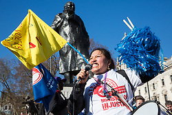 London, UK. 26th February, 2019. Susana Benavides, who was last week awarded £75,000 in compensation by an employment tribunal after being dismissed unfairly from her subcontracted cleaning job at Topshop, addresses mainly migrant striking outsourced workers belonging to the Independent Workers of Great Britain (IWGB), United Voices of the World (UVW) and Public and Commercial Services Union (PCS) trade unions working at the University of London (IWGB), Ministry of Justice (UVW) and Department for Business Energy and Industrial Strategy (PCS), together with representatives of the National Union of Rail, Maritime and Transport Workers (RMT) Regional Council, taking part in a 'Clean Up Outsourcing' demonstration to call for an end to the practice of outsourcing. The demonstration was organised to coincide with a significant High Court hearing of an application by the IWGB for judicial review of a decision by the Central Arbitration Committee (CAC) not to hear their application for trade union recognition for the purposes of collective bargaining with the University of London.
