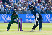 Jason Roy of England hits the ball over the boundary for six runs during the third Royal London One Day International match between England and Pakistan at the Bristol County Ground, Bristol, United Kingdom on 14 May 2019.