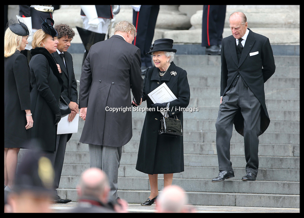 The Queen talks to Baroness Thatcher's family on the steps of  St.Paul's Cathedral in London at the end of her funeral Wednesday 17th  April 2013 Photo by: Stephen Lock / i-Images