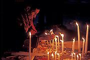GUATEMALA, FESTIVALS Semana Santa (Easter Week) in Chichicastenango, Indian lighting candles in the church