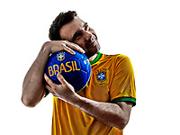 one man with Brazilian jersey hugging soccer ball isolated in white background