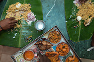 Lunch served on a banana leaf in a Kariakudi mess, Tamil Nadu, India