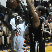 New Hanover's Lawrence Williams shoots over Ashley's Bryston Davis Friday December 19, 2014 at New Hanover High School in Wilmington, N.C. (Jason A. Frizzelle)