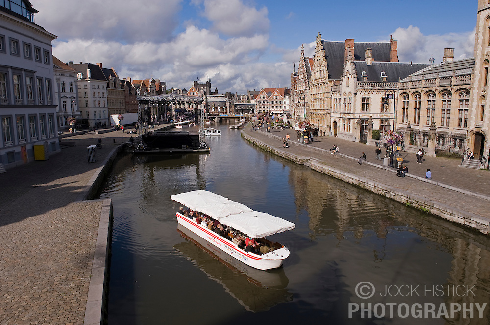 A canal boat full of tourists makes its way through the old harbor of Ghent, in Ghent, Belgium, on Friday, Sept. 12, 2008. (Photo © Jock Fistick)