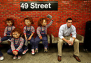 """Actors playing the horror icon Chucky whack Kevin Salmon, of Hoboken, N.J.,  Tuesday, Sept. 9, 2008, in New York, to celebrate the release of """"Child's Play, Chucky's 20th Birthday Edition"""" DVD. (Photo by Diane Bondareff)"""