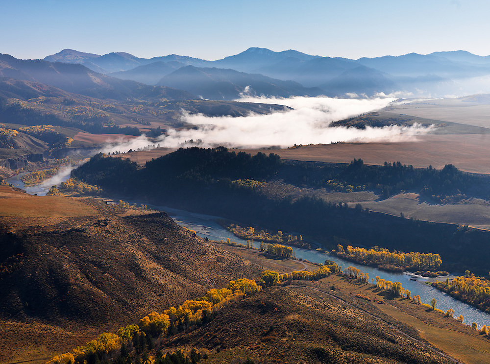 Mornign fog lifting off the South Fork of the Snake River above Heise and below the South Fork Lodge on a stunning autum morning in Eastern Idaho