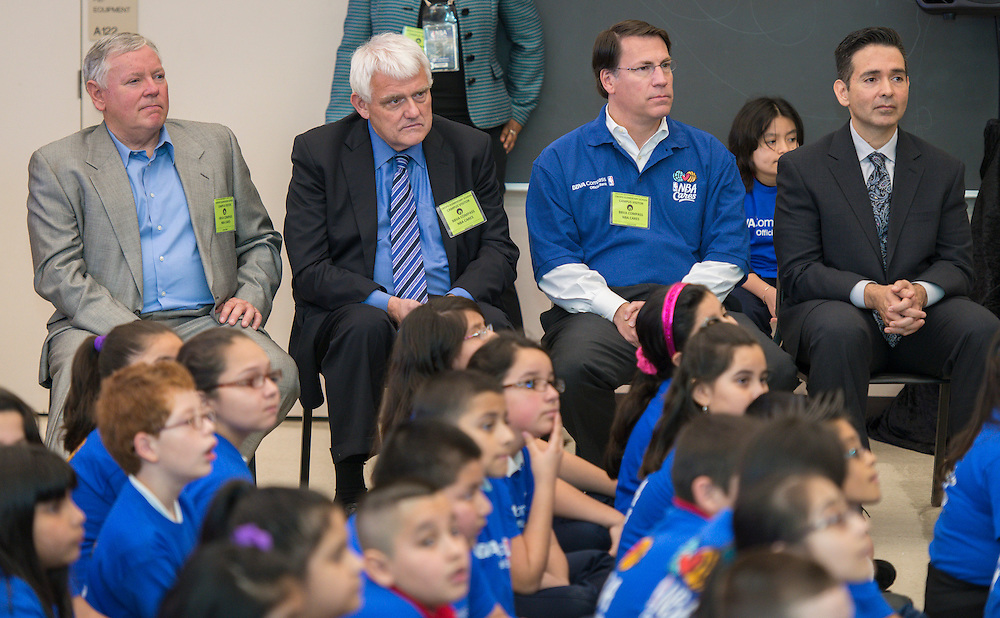 L-R: Houston ISD Chief School Officer Dr. Sidney Zullinger, School Support Officer James Benfield, BBVA Compass Houston City President Mark Montgomery and Principal Auden Sarabia listen as NBA legends and BBVA Compass staff talk with students during a financial education and success program sponsored by NBA Cares and BBVA Compass at Crespo Elementary School, February 27, 2014.