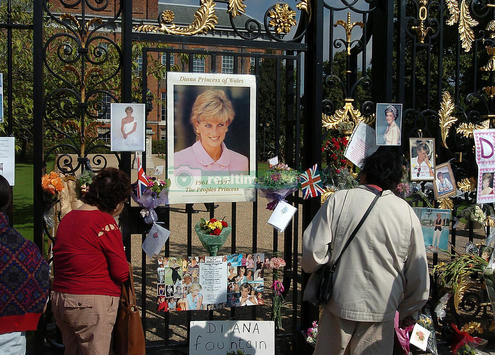 Public gather at the gates of Kennsington Palace in London to pay tribute at the home of the Princess Diana on the seventh anniversary of her death.