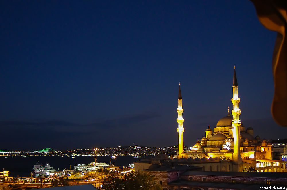 The Golden Horn glitters in the night sky.
