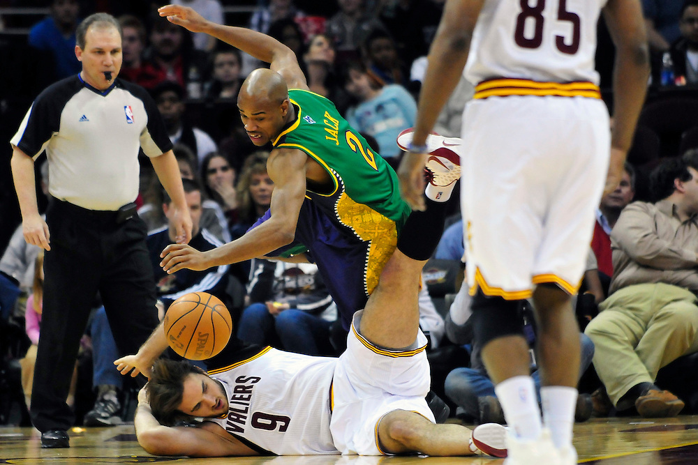 March 6, 2011; Cleveland, OH, USA; Cleveland Cavaliers center Semih Erden (9) and New Orleans Hornets point guard Jarrett Jack (2)  scramble for a loose ball during the second quarter at Quicken Loans Arena. Mandatory Credit: Jason Miller-US PRESSWIRE