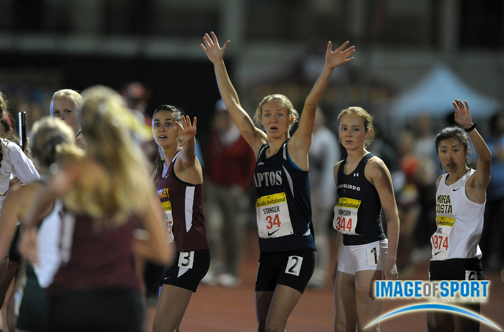 Apr 6, 2012; Arcadia, CA, USA; Runners await the handoff in the girls 4 x 1,600m relay in the Arcadia Invitational at Arcadia High. From left: Karla Vernola of Simi Valley and Jackie Stanger of Aptos and Rachel Johnson of Campolindo and Abby Hong of Mira Costa.