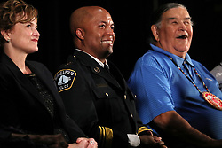 Newly-appointed Minneapolis Police Chief Medaria Arradondo, middle, sits between Clyde Bellecourt and Mayor Betsy Hodges during a public swearing-in ceremony for Arradondo on Friday, Sept. 8, 2017, at the Sabathani Community Center in Minneapolis. (Photo by Anthony Souffle/Minneapolis Star Tribune/TNS/Sipa USA)