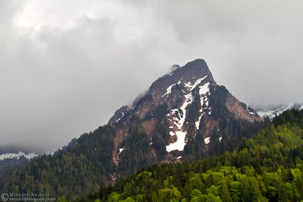 Clouds envelop a ridge on Mount Cheam in the Fraser Valley of British Columbia, Canada