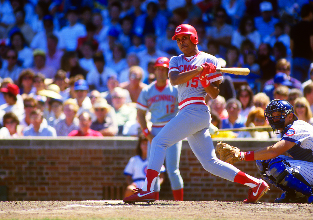 CHICAGO - AUGUST 22:  Barry Larkin of the Cincinnati Reds bats against the Chicago Cubs during an MLB game at Wrigley Field in Chicago, Illinois.  Larkin made his major league debut a few weeks earlier in Cincinnati. Larkin played for the Reds from 1986-2004.   (Photo by Ron Vesely)   Subject: Barry Larkin.