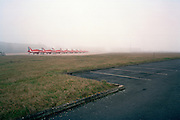 BAE System Hawks of the Red Arrows, Britain's RAF aerobatic team and airfield mist landscape.