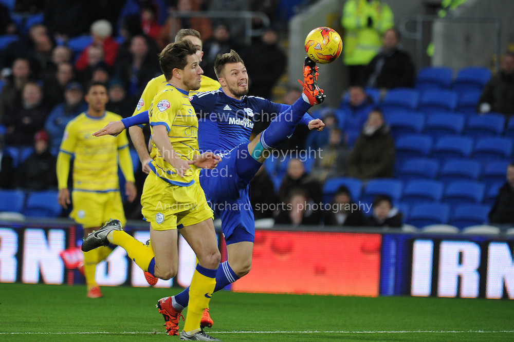 Anthony Pilkington of Cardiff city tries to bring the ball down. Skybet football league championship match, Cardiff city v Sheffield Wednesday at the Cardiff city stadium in Cardiff, South Wales on Saturday 12th December 2015.<br /> pic by Andrew Orchard, Andrew Orchard sports photography.