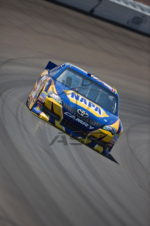 BROOKLYN, MI - JUN 14, 2012:  Martin Truex, Jr. (56) brings his car through the turns during the second test session for the Quicken Loans 400 at the Michigan International Speedway in Brooklyn, MI.