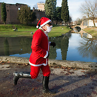 NOALE, ITALY - DECEMBER 18: One participant dressed as Father Christmas takes part in the Noale Santa Run on December 18, 2011 in Noale, Italy. Close to two thousand people participated in the third annual Noale Santa Run, one of the largest non competitive Santa Run in Italy.
