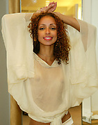 NEW YORK - SEPTEMBER 11: ***EXCLUSIVE*** (TABLOIDS OUT) Sexy Singer Mya getting pretty for Fashion Week at Luca Luca's Madison Avenue Boutique.  September 11, 2002 in New York City, New York.  The singer will attend the Luca Luca show on Wednesday night at 8pm at Bryant Park (Photo by Matthew Peyton)
