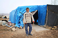 ARBAT, IRAQ: Abbas Tammo, 9 , from Amode, Syria, is pictured in a refugee camp in Arbat, Iraq. ..The semi-autonomous region of Iraqi Kurdistan has accepted refugees from the conflict in Syria into several camps. Arbat lies near Sulaimaniyah in northeastern Iraq, approximately 500 kilometres from the Syrian border...Photo by Besaran Tofiq/Metrography