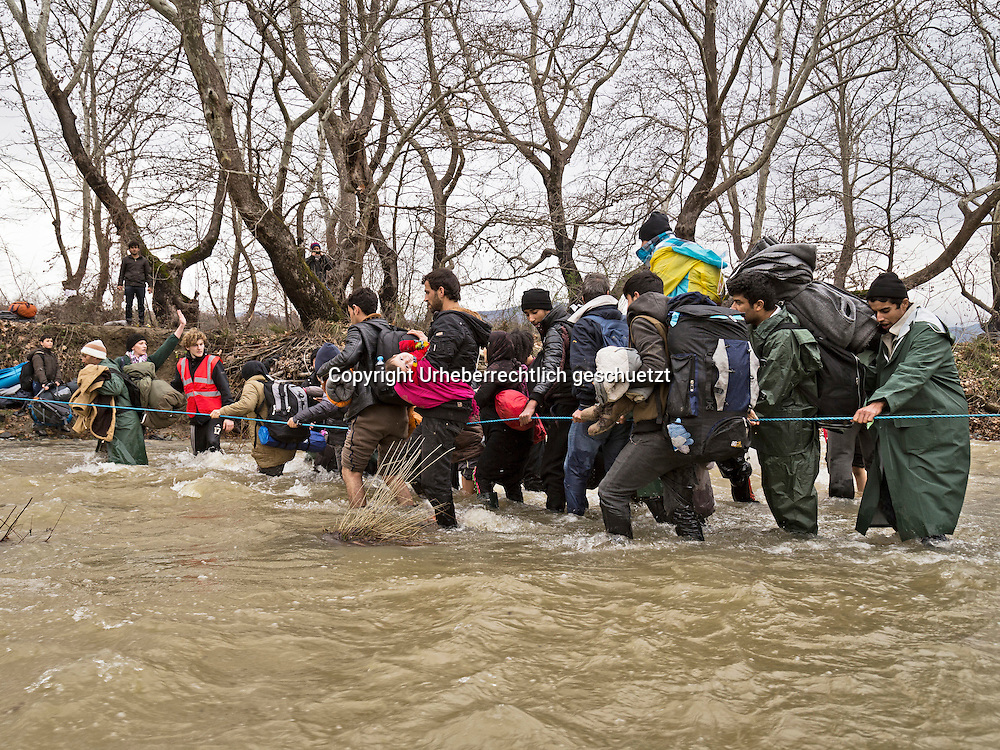 Greece, Idomeni, Refugees on their way to Europe,   March of Hope<br /> <br /> Refugees from Syria, Irak, Afghanistan and others from the near east are trying to reach the border between Greece and Macedonia (FYROM), they had to cross the small river Suva Reka, near the village Hamilo. <br /> <br /> Nadeloehr nach Nordeuropa Idomeni, der Grenzuebergang ist seit Tagen gesperrt,. <br /> Es ensteht im provisorischen Fluechtlingslager in Idomeni eine ngespannte Lage. <br /> Regen und Kaelte machen vor allem den Familien mit kleinen Kindern zu schaffen. <br /> <br /> Idomeni, is the eye of a needle for getting to nothern Europe. <br /> The FYRO macedonian authorities, closed the border from Greece completely. The situation close to the border gets more and more difficult. The People have to sleep outside or in small tents. <br /> Heavy rainfalls and cold nights are treating the refugees badly. Some already stayed up to ten nights at Idomeni. There is not enough food and supplies to help about 14.000 refugees<br /> <br /> <br /> keine Veroeffentlichung unter 50 Euro*** Bitte auf moegliche weitere Vermerke achten***Maximale Online-Nutzungsdauer: 12 Monate !! <br /> <br /> for international use:<br /> Murat Tueremis<br /> C O M M E R Z  B A N K   A G , C o l o g n e ,  G e r m a n y<br /> IBAN: DE 04 370 800 40 033 99 679 00<br /> SWIFT-BIC: COBADEFFXXX