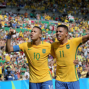 Football - Olympics: Day 12 Neymar #10 of Brazil celebrates a goal by team mate Gabriel Jesus #11 of Brazil during the Brazil Vs Honduras Men's Semifinal match at Maracana Stadium on August 17, 2016 in Rio de Janeiro, Brazil. (Photo by Tim Clayton/Corbis via Getty Images)