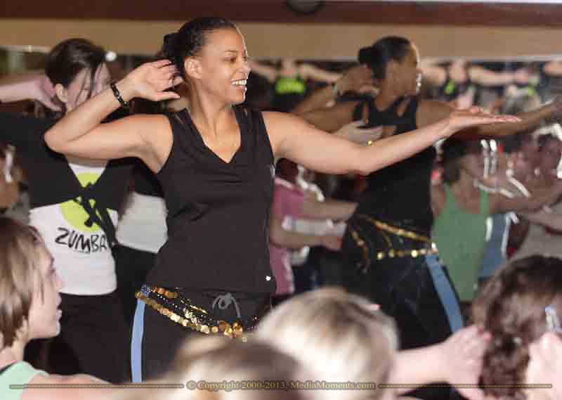 Wendy Dechellis from Englewood takes the stage during the grand opening of Studio Zumba in Vandalia, Sunday, January 28, 2007.