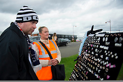 A fan takes a look at pin badges on display outside the iPro Stadium - Photo mandatory by-line: Dougie Allward/JMP - Mobile: 07966 386802 30/08/2014 - SPORT - FOOTBALL - Derby - iPro Stadium - Derby County v Ipswich Town - Sky Bet Championship