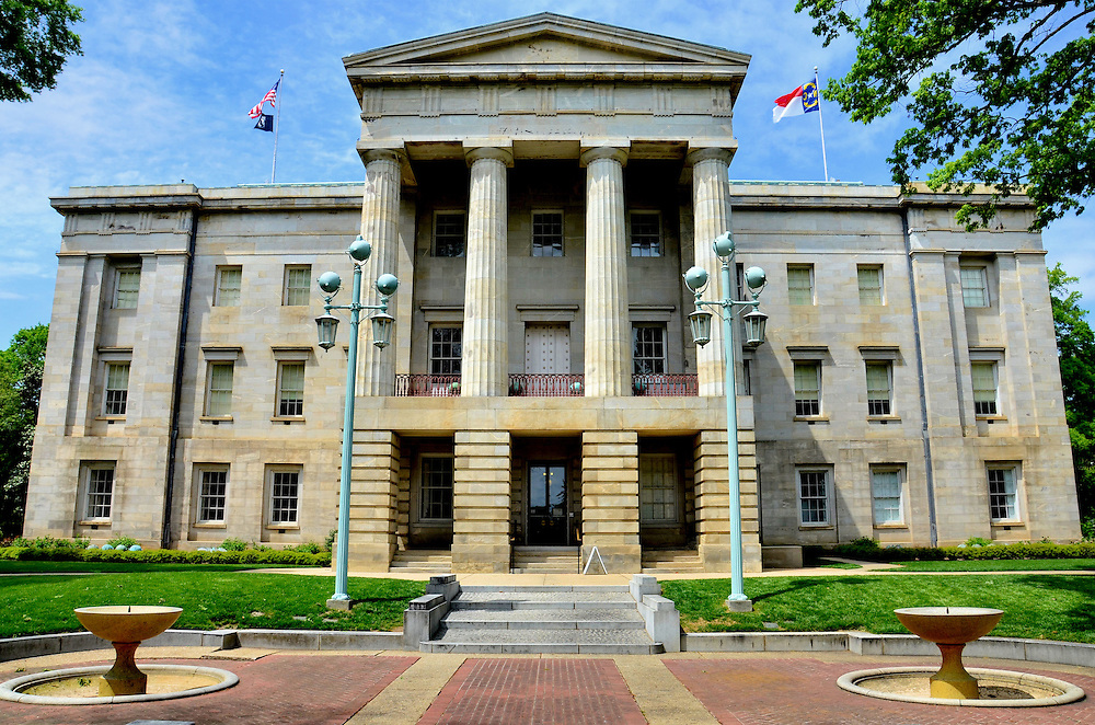 North Carolina State Capitol Building in Raleigh, North Carolina<br /> The face of North Carolina&rsquo;s State Capitol in Raleigh features a Greek style portico with Doric columns. A mule-powered railway was built to transport local granite to the site. The three-story building with its copper dome was completed in 1840. North Carolina became the 12th state on November 21, 1789.