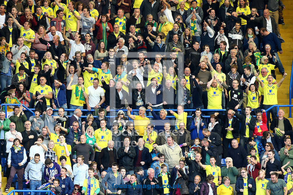Picture by Paul Chesterton/Focus Images Ltd +44 7904 640267.06/10/2012.The traveling Norwich fans celebrate their sides goal during the Barclays Premier League match at Stamford Bridge, London.