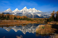 The Tetons are reflected in the clam waters of a beaver pond at Schwabacher's Landing